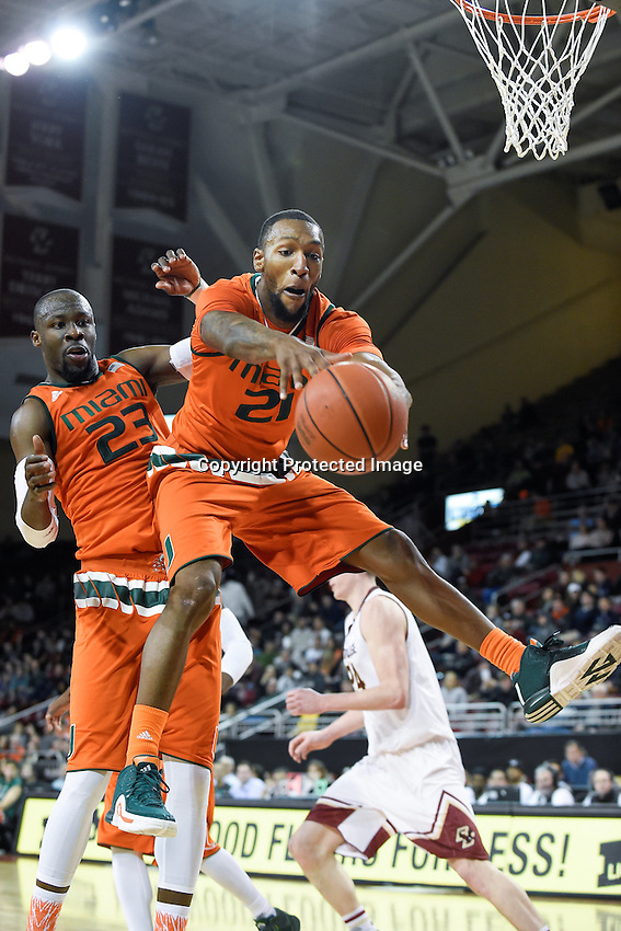 Wednesday January 20, 2016: Miami (Fl) Hurricanes forward Kamari Murphy (21) reaches for a rebound before it goes out of bounds during the second half of the NCAA men's basketball game between the Miami Hurricanes and the Boston College Eagles at Conte Forum, in Chestnut Hill, Mass.  Miami beats Boston 67-53. Eric Canha/CSM