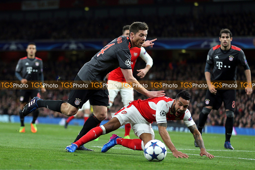 Arsenal's Theo Walcott goes to ground in search of a penalty after a challenge from FC Bayern Munich's Xabi Alonso during Arsenal vs FC Bayern Munich, UEFA Champions League Football at the Emirates Stadium on 7th March 2017