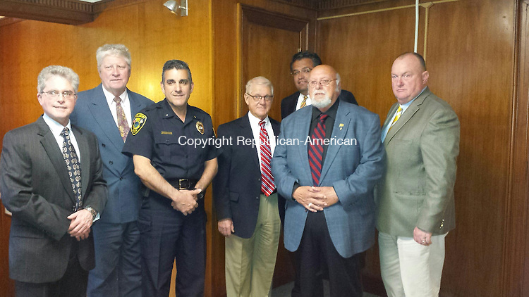 MIDDLEBURY, CT: 20 May 2015:052015BB02: MIDDLEBURY --- Police Chief James Viadero and First Selectman Edward B. St. John, center, pose for a photo with the Police Commission before its meeting Monday. Commissioners include, from left, Ken Heidkamp, Frank Barton Jr., George Moreira, Chairman Frank Cipriano and Paul Bowler. Bill Bittar Republican-American
