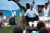 United States President Barack Obama (2nd R) and first lady Michelle Obama host a group of Girl Scouts for a campout on the South Lawn of the White House June 30, 2015 in Washington, DC.  The first family hosted the event as part of the first lady's Let's Move! Outside initiative and for Girl Scouts to earn the new Girls' Choice Outdoor badge. <br /> Credit: Chip Somodevilla / Pool via CNP