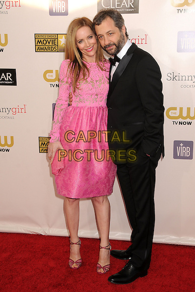 Leslie Mann, Judd Apatow.18th Annual Critics' Choice Movie Awards - Arrivals held at Barker Hangar, Santa Monica, California, USA, .10th January 2013 .full length pink gold print dress top long sleeve skirt clutch bag strappy sandals lace cut out shoes married couple husband wife black tuxedo bow tie suit .CAP/ADM/BP.©Byron Purvis/AdMedia/Capital Pictures.