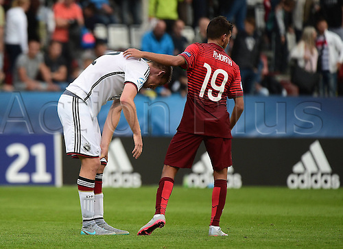 27.06.2015. Andruv Stadium, Olomouc, Czech Republic. U21 European championships, semi-final. Portugal versus Germany.  Dominique Heintz (Germany) is consoled by Ricardo Horta (Portugal)
