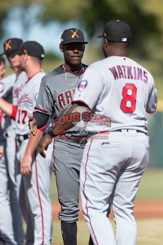 Salt River Rafters shortstop Jazz Chisholm (1), of the Arizona Diamondbacks organization, shakes hands with manager Tommy Watkins (8) during player introductions before the Arizona Fall League Championship Game against the Peoria Javelinas at Scottsdale Stadium on November 17, 2018 in Scottsdale, Arizona. Peoria defeated Salt River 3-2 in 10 innings. (Zachary Lucy/Four Seam Images)
