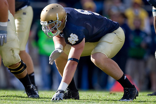 Notre Dame tight end Kyle Rudolph (#9) in three point stance in game action during NCAA football game between the Notre Dame Fighting Irish and the Purdue Boilermakers.  Notre Dame defeated Purdue 23-12 in game at Notre Dame Stadium in South Bend, Indiana.