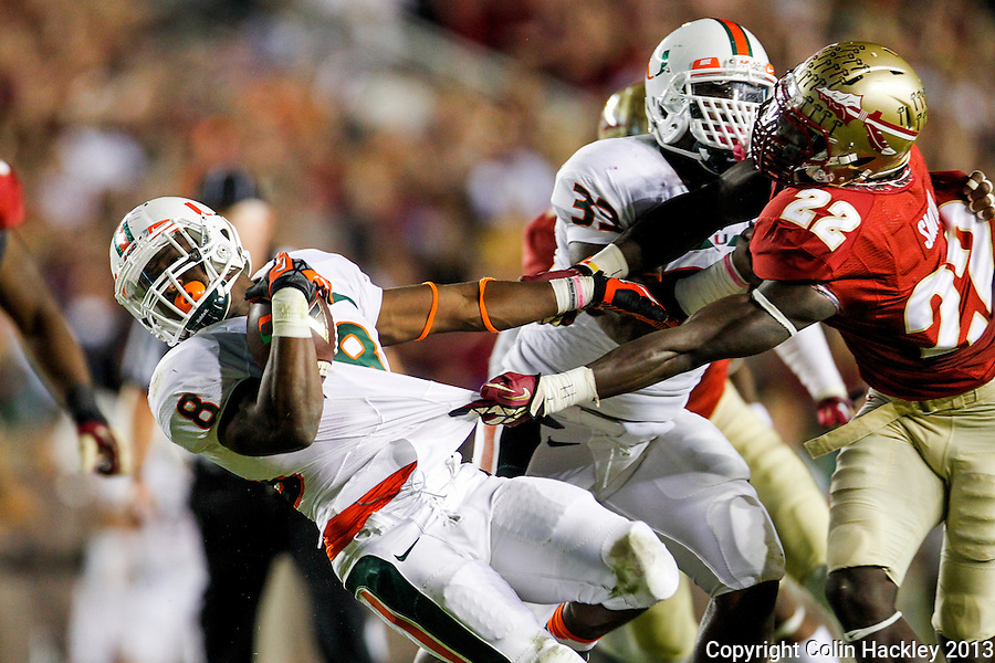 TALLAHASSEE, FL 11/2/13-FSU-MIAMI110213CH-Florida State's Telvin Smith, right, can't hang on to Miami's Duke Johnson, left, during first half action Saturday at Doak Campbell Stadium in Tallahassee. <br /> COLIN HACKLEY PHOTO