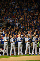 Chicago Cubs (L-R) Mike Montgomery, Travis Wood, Jon Lester, Joe Smith, and Rob Zastrynzy stand for the national anthem before before Game 3 of the Major League Baseball World Series against the Cleveland Indians on October 28, 2016 at Wrigley Field in Chicago, Illinois.  (Mike Janes/Four Seam Images)