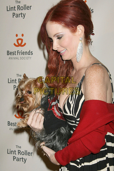 PHOEBE PRICE.14th Annual Lint Roller Party presented by The Best Friends Animal Society held on The Jim Henson Company Lot, Las Vegas, Nevada, USA..November 10th, 2007.half length black white zebra animal print dress dog animal red wrap earrings profile .CAP/ADM/RE.©Russ Elliot/AdMedia/Capital Pictures.