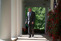 Director of National Intelligence Dan Coats walks along the colonnade outside the Oval Office prior to a National Day of Prayer event in the Rose Garden at the White House in Washington, DC on May 3, 2018. Credit: Alex Edelman / Pool via CNP /MediaPunch