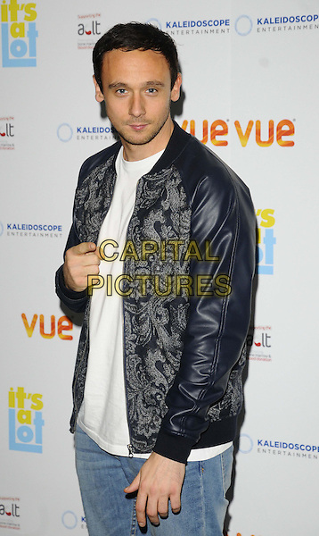 Jason Maza<br /> The &quot;It's A Lot&quot; UK film premiere, Vue West End cinema, Leicester Square, London, England.<br /> October 21st, 2013<br /> half length black jacket blue white paisley jeans denim hand finger pointing <br /> CAP/CAN<br /> &copy;Can Nguyen/Capital Pictures