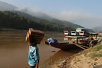A worker is carrying goods at Pak Beng, a commercial town between Houa Xai and Luang Prabang, Laos-2010