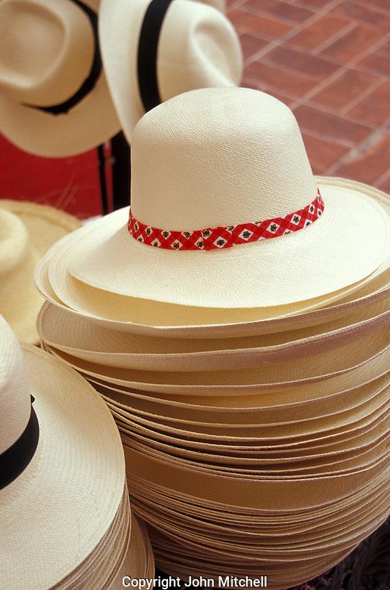 Stack of Panama hats or sombreros de paja toquilla for sale in Ecuador, South America