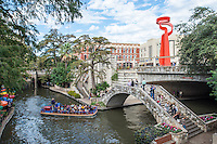 This is such a lovely view of the river walk in San Antonio where the Torch of Friendship, along with the many lovely bridges with the river boat running through.