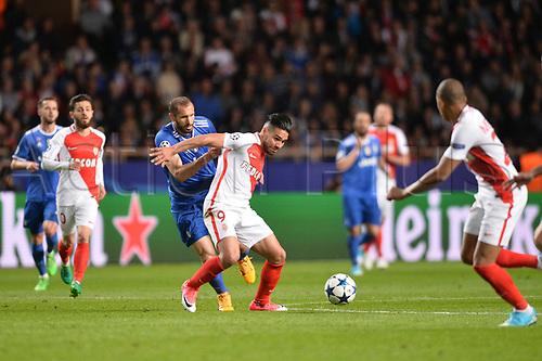 Monaco,France; UEFA Champions league football semi-final, AS Monaco versus Juventus; RADAMEL FALCAO (mon) shields the ball from Giorgio Chiellini (juv)