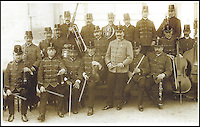 BNPS.co.uk (01202 558833)<br /> Pic: TennysonEkeberg/BNPS<br /> <br /> And the band played on...<br /> <br /> Wallace Hartley(4th left front) in the Bridlington Band.<br /> <br /> The violin played by the bandmaster on the Titanic as the ship was sinking is finally being auctioned for an estimated &pound;400,000.<br /> <br /> The wooden instrument has been proven to be the one used by Wallace Hartley as his band famously played on to help keep the passengers calm during the disaster.<br /> <br /> Its existence and survival only emerged in 2006 when the son of an amateur violinist who was gifted it by her music teacher in the early 1940s contacted an auctioneers.