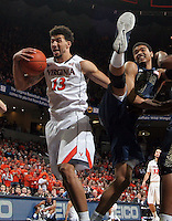 Virginia forward Anthony Gill (13) grabs a rebound next to Georgia Tech forward Robert Sampson (13) during an NCAA basketball game Thursday Jan. 22, 2015, in Charlottesville, Va. (Photo/Andrew Shurtleff)
