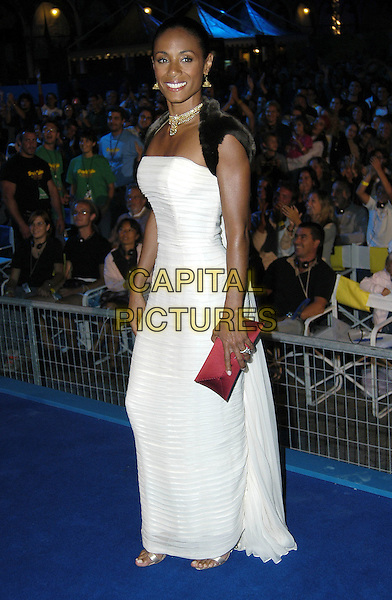 JADA PINKETT SMITH.Premiere of Shark Tale held in the open air in St. Mark's Square during the Venice Film Festival, Italy,.10th September 2004. .full length long white dress black fur shawl stole wrap jacket red clutch bag.Ref: KRA.www.capitalpictures.com.sales@capitalpictures.com.©Capital Pictures.