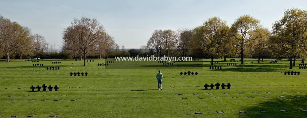 25 April 2004 - La Cambe, France - A visitor walks through the German military cemetary in La Cambe, France, 25 April 2004. With over 21 200 tombs, this cemetary is the largest German military cemetary of the region.