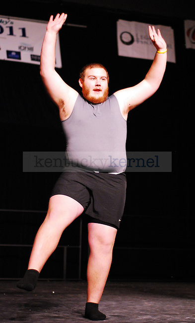 A Phi Sigma Kappa brother dances  in the 2011 Greek Sing event held at Memorial Coliseum in Lexington, Ky. on Feb. 5, 2011. Photo by Ryan Buckler | Staff