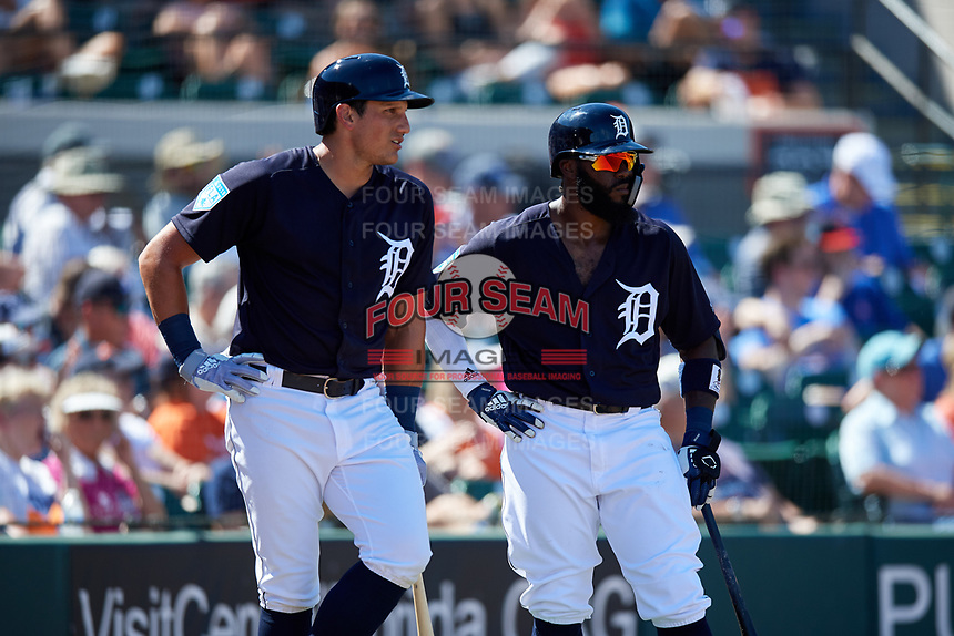 Detroit Tigers left fielder Mikie Mahtook (8) and second baseman Josh Harrison (1) stand in the on deck circle during a Grapefruit League Spring Training game against the Atlanta Braves on March 2, 2019 at Publix Field at Joker Marchant Stadium in Lakeland, Florida.  Tigers defeated the Braves 7-4.  (Mike Janes/Four Seam Images)