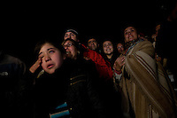 relatives of the 33 waiting as the capsule of Florecio Avalo reach the surface. Relatives of the trapped miners react to their final rescue in San Jose mine, north of Chile