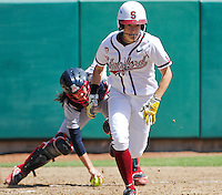 STANFORD, CA - April 3, 2011:  Jenna Rich lays down a sacrifice bunt during Stanford's 2-0 loss to Arizona at Stanford, California on April 3, 2011.