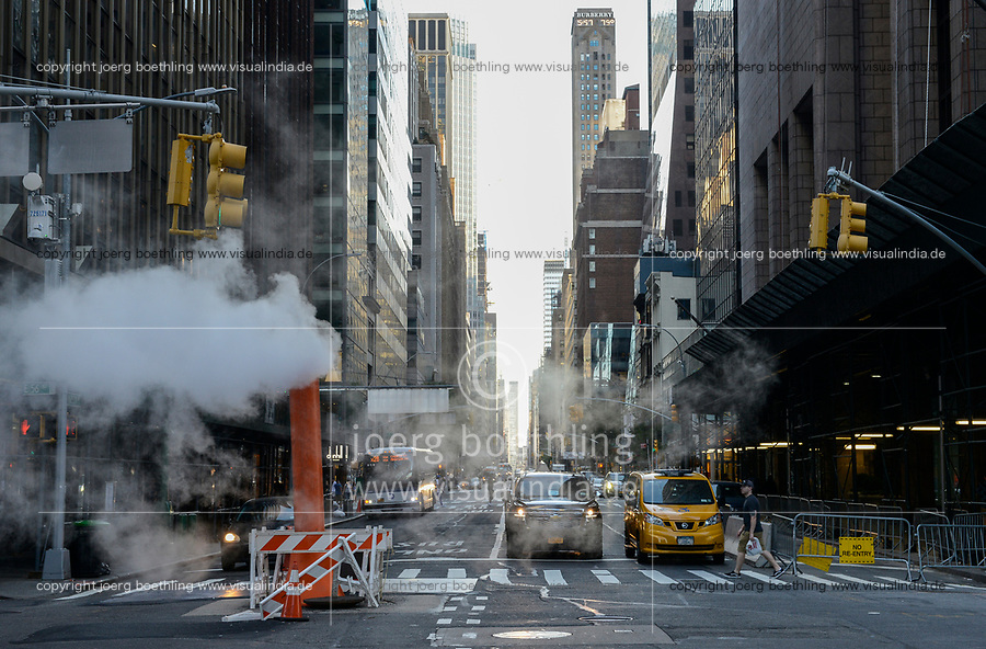 USA, New York City, Manhattan, Madison Avenue, busy street with steam pipe