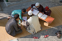 Imam Listens as Madrasa Students Read their Koranic Lessons, Madrasa Imdadul Uloom, Dehradun, India.