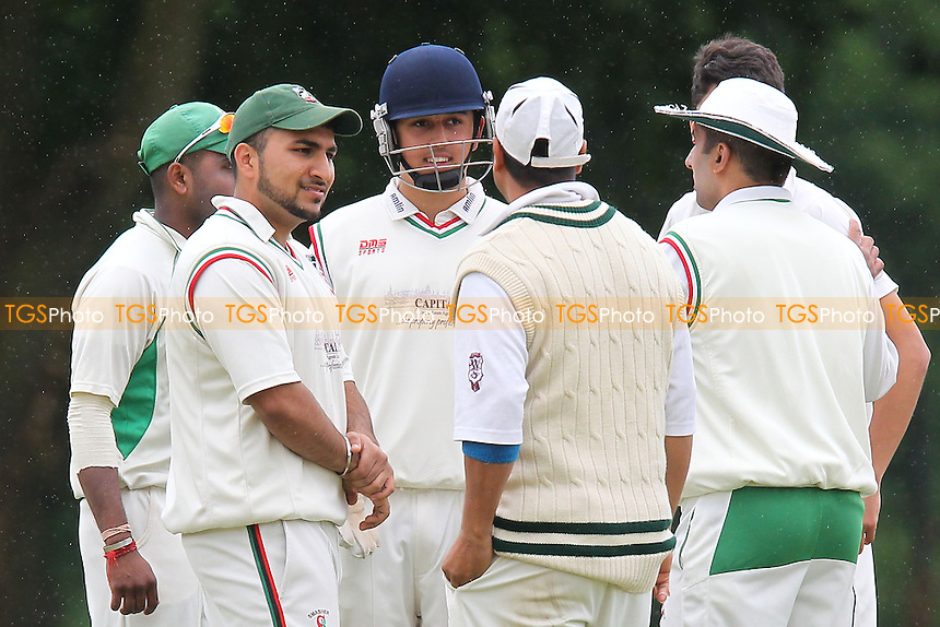 Ilford players celebrate the wicket of Arfan Akram - Wanstead CC vs Ilford CC - Essex Cricket League at Overton Drive - 15/06/13 - MANDATORY CREDIT: Gavin Ellis/TGSPHOTO - Self billing applies where appropriate - 0845 094 6026 - contact@tgsphoto.co.uk - NO UNPAID USE