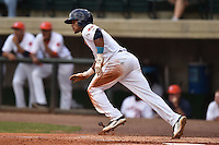 Greenville Astros center fielder Jason Martin #4 swings at a pitch during a game against the Pulaski Mariners at Pioneer Park July 12, 2014 in Greenville, Tennessee. The Mariners defeated the Astros 11-10. (Tony Farlow/Four Seam Images)