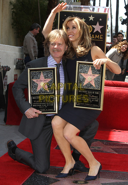 William H. Macy & Felictiy Huffman .Felictiy Huffman And William H. Macy Hollywood Walk Of Fame Induction Ceremony Held At On the Walk of Fame, Hollywood, California, USA.  .March 7th, 2012.full length moustache mustache facial hair married husband wife black suit dress suit kneeling sitting on knee hand arm waving looking up.CAP/ADM/KB.©Kevan Brooks/AdMedia/Capital Pictures.