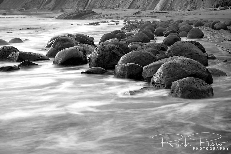 The spherical sandstone concretions on Bowling Ball Beach within Schooner Gulch State Beach along the Mendocino coastline in California can only be seen at low tide