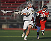 Jamie Atkinson #5 of Garden City, left, gets pressured by Ben Robbins #10 of Syosset during a non-league varsity boys lacrosse game at Garden City High School on Tuesday, Mar. 22, 2016. Syosset won by a score of 6-3.