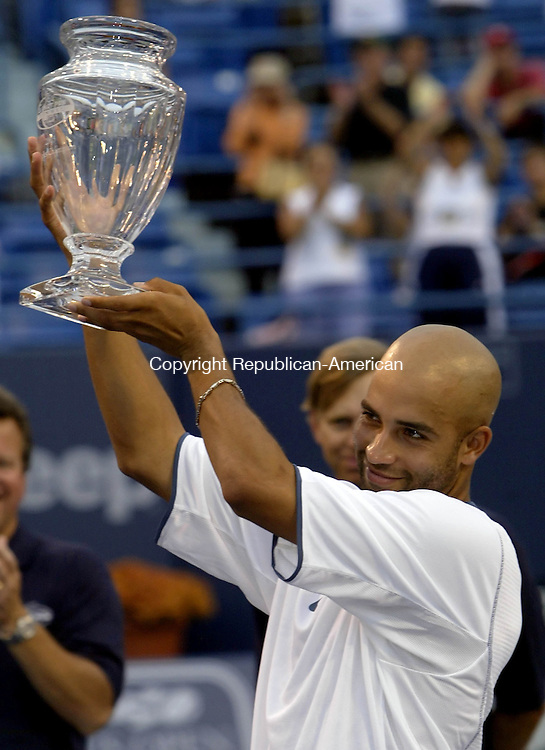 NEW HAVEN, CT--28 AUGUST 2005- 082805JS04--James Blake (USA) holds up the Pilot Pen championship trophy after defeating Feliciano Lopez (ESP) in the Pilot Pen Tennis Tournament Sunday in New Haven.    Jim Shannon / Republican American--New Haven; Pilot Pen; James Blake, Feliciano Lopez are CQ
