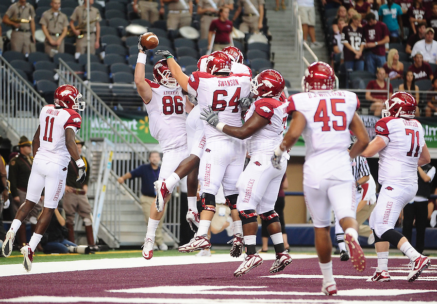 Oct. 9, 2010; Arlington, TX, USA; Arkansas Razorbacks tight end (86) Ben Cleveland celebrates a touchdown catch with teammates in the second quarter against the Texas A&M Aggies at Cowboys Stadium. Mandatory Credit: Mark J. Rebilas-