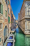 A narrow canal alongside the church of Santa Maria dei Miracoli in Cannaregio, Venice Italy.