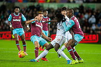 Bafetibis Gomis of Swansea in action surrounded by West ham players during the Barclays Premier League match between Swansea City and West Ham United played at the Liberty Stadium, Swansea  on December 20th 2015