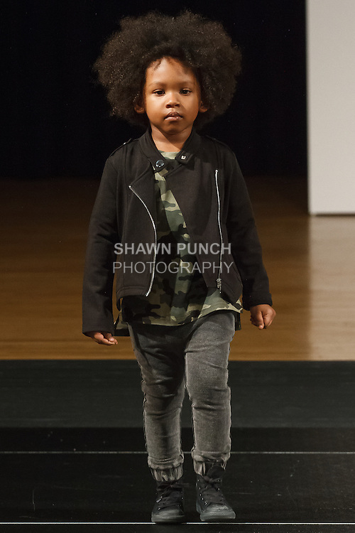 Model walks runway in an outfit by Lil XO Kings, during the petitePARADE Children's Club fashion show at the Jacob Javits Center in New York City, on January 9, 2016.