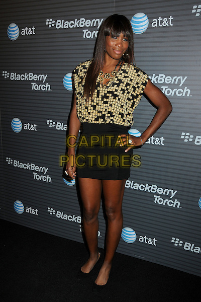 VENUS WILLIAMS.BlackBerry Torch Launch Party held at 5900 Wilshire, Los Angeles, California, USA..August 11th, 2010.full length black skirt gold pattern print sleeveless top squares .CAP/ADM/BP.©Byron Purvis/AdMedia/Capital Pictures.