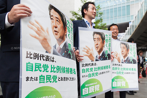 Members of staff hold posters of the Liberal Democratic Party during a campaign event of candidates Masaharu Nakagawa and Kentaro Asahi in Akihabara on July 9, 2016, Tokyo, Japan. Shinzo Abe, leader of the Liberal Democratic Party and Prime Minister of Japan delivered his last campaign speech before the July 10th House of Councillors elections. (Photo by Rodrigo Reyes Marin/AFLO)