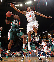 Jan. 6, 2011; Charlottesville, VA, USA; Miami Hurricanes guard Shenise Johnson (42) grabs the rebound in front of Virginia Cavaliers center Simone Egwu (4) during the game at the John Paul Jones Arena. Miami won 82-73. Mandatory Credit: Andrew Shurtleff-