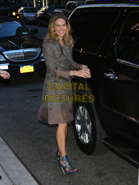 HILARY SWANK.Hilary Swank at the Ed Sullivan Theater for an appearance on the 'Late Show with David Letterman', New York, NY, USA..October 13th, 2010.full length beige grey gray print coat jacket blue strappy sandals car.CAP/LNC/TOM.©LNC/Capital Pictures.