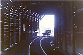 Interior of D&amp;RGW Cumbres wye snowshed west end, looking west.  Section motor in opening.<br /> D&amp;RGW  Cumbres, CO  ca. 1960