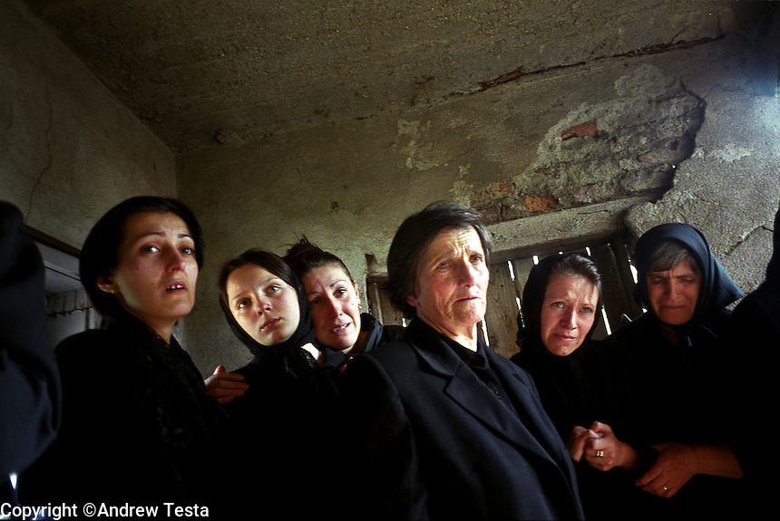 KOSOVO. Janjiva Voda. 17/10/2000..Relatives of Radovan Ognjenovic mourn at his funeral. He was killed after his tractor drove over an anti tank mine newly planted on a road used exclusively by Serbs..©Andrew Testa