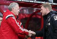 Swansea City First team coach Alan Curtis and Bournemouth Manager Eddie Howe  shake hands before the Barclays Premier League match between AFC Bournemouth and Swansea City played at The Vitality Stadium, Bournemouth on March 11th 2016