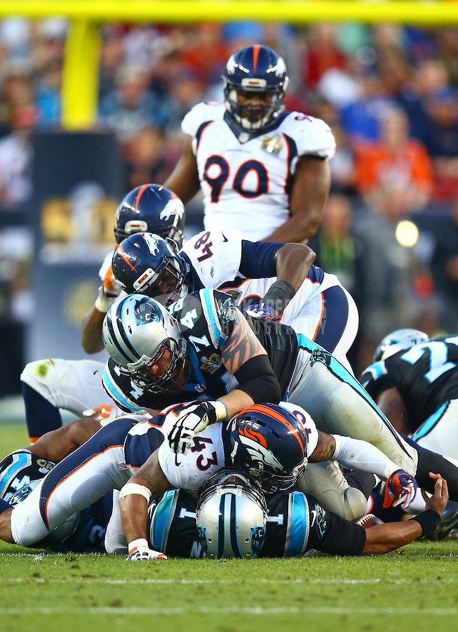 Feb 7, 2016; Santa Clara, CA, USA; Carolina Panthers quarterback Cam Newton (1) at the bottom of the pile after being tackled by Denver Broncos by safety T.J. Ward (43) and linebacker Shaquil Barrett (48) in the first half in Super Bowl 50 at Levi's Stadium. Mandatory Credit: Mark J. Rebilas-USA TODAY Sports