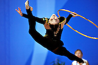Alina Maksymenko of Ukraine performs split leap with hoop at 2010 Pesaro World Cup on August 29, 2010 at Pesaro, Italy.  Photo by Tom Theobald.
