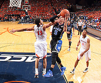 Duke guard Tyus Jones (5) defended by Virginia forward Anthony Gill (13) during an ACC basketball game Jan. 31, 2015 in Charlottesville, VA. Duke won 69-63.