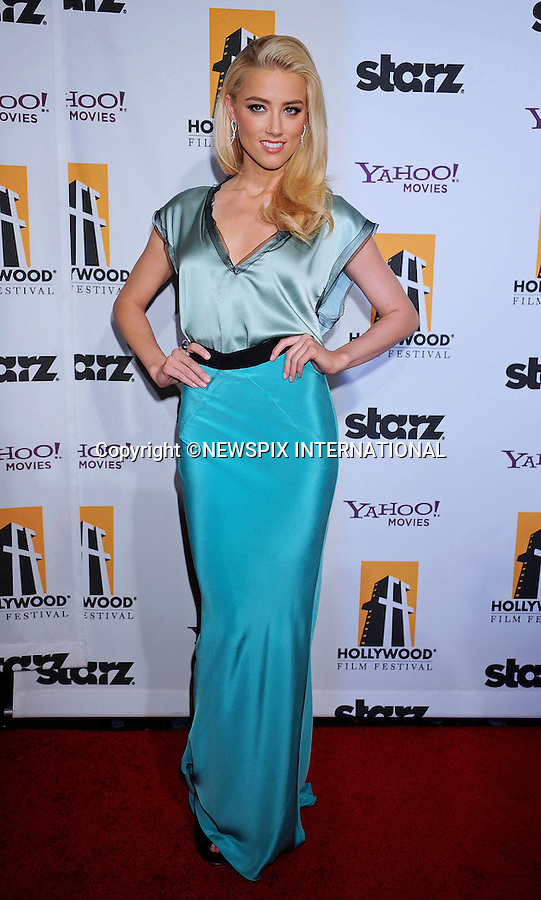 """AMBER HEARD.attends the 15th Annual Hollywood Film Awards Gala Presented By Starz at the Beverly Hilton Hotel, Beverly Hills, Los Angeles_24/10/2011.Mandatory Photo Credit: ©Crosby/Newspix International. .**ALL FEES PAYABLE TO: """"NEWSPIX INTERNATIONAL""""**..PHOTO CREDIT MANDATORY!!: NEWSPIX INTERNATIONAL(Failure to credit will incur a surcharge of 100% of reproduction fees).IMMEDIATE CONFIRMATION OF USAGE REQUIRED:.Newspix International, 31 Chinnery Hill, Bishop's Stortford, ENGLAND CM23 3PS.Tel:+441279 324672  ; Fax: +441279656877.Mobile:  0777568 1153.e-mail: info@newspixinternational.co.uk"""