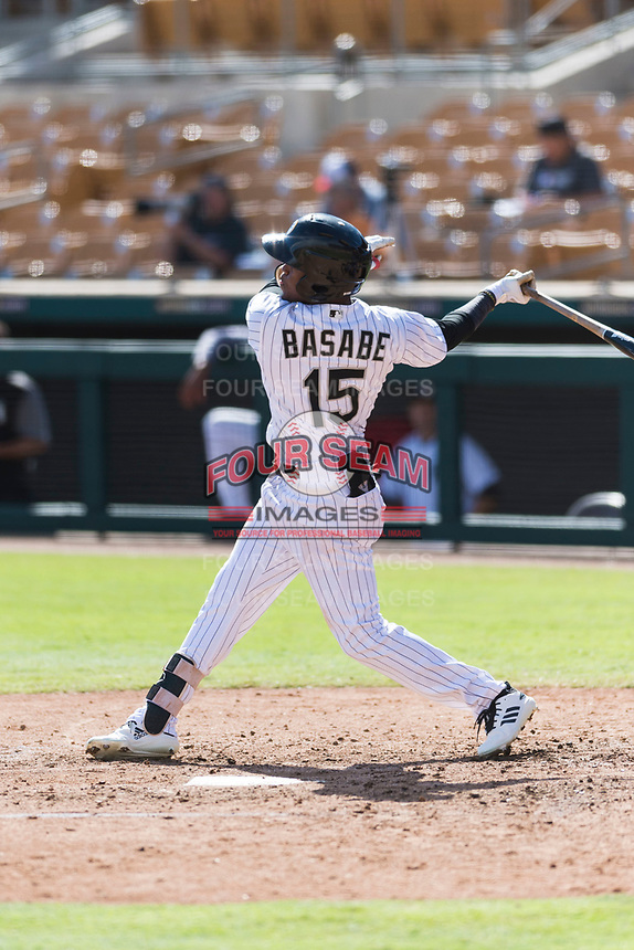 Glendale Desert Dogs center fielder Luis Alexander Basabe (15), of the Chicago White Sox organization, follows through on his swing during an Arizona Fall League game against the Scottsdale Scorpions at Camelback Ranch on October 16, 2018 in Glendale, Arizona. Scottsdale defeated Glendale 6-1. (Zachary Lucy/Four Seam Images)