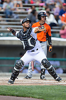 Lynchburg Hillcats catcher Juan De La Cruz (44) makes a throw to second base against the Frederick Keys at Calvin Falwell Field at Lynchburg City Stadium on May 14, 2015 in Lynchburg, Virginia.  The Hillcats defeated the Keys 6-3.  (Brian Westerholt/Four Seam Images)